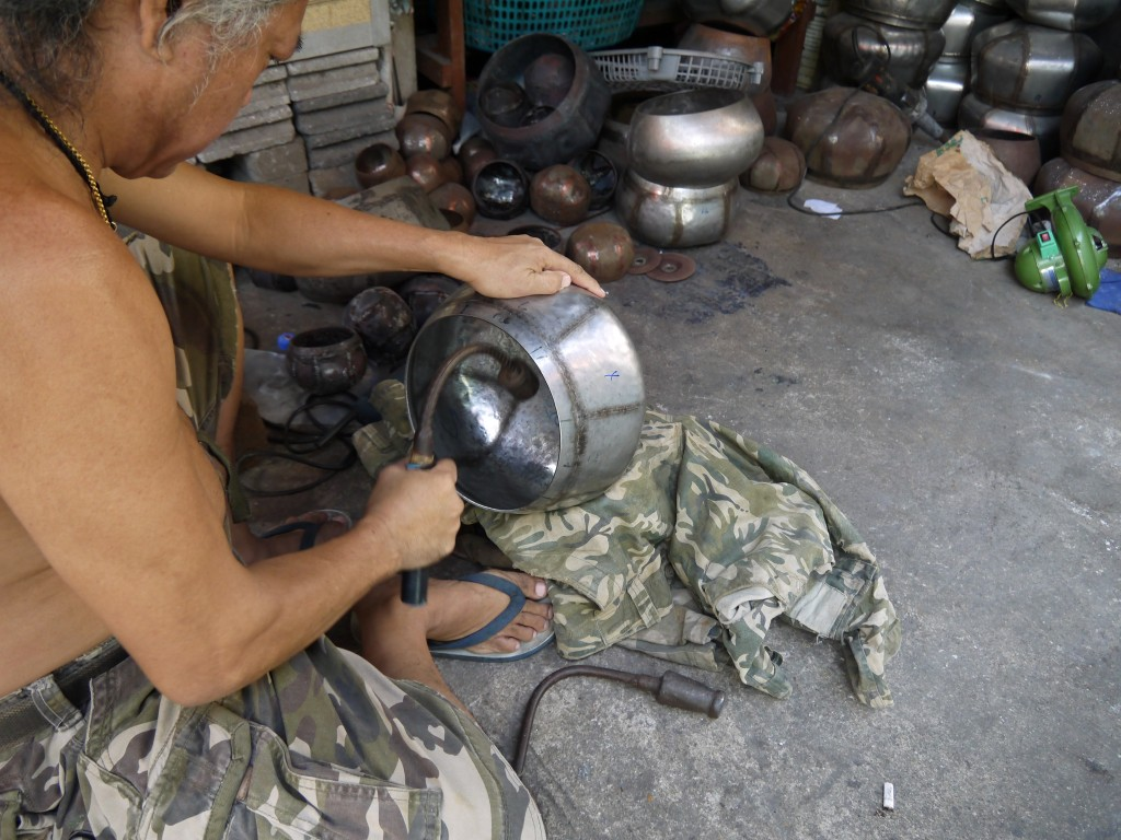 Somsak Hammering A Monk's Bowl Into Shape