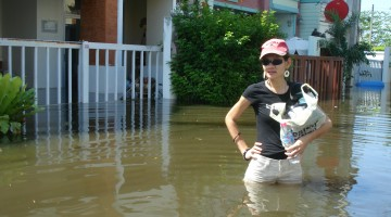 Miu Outside Her Flooded House