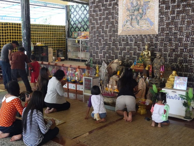 People Praying At The Million Bottle Temple, Thailand