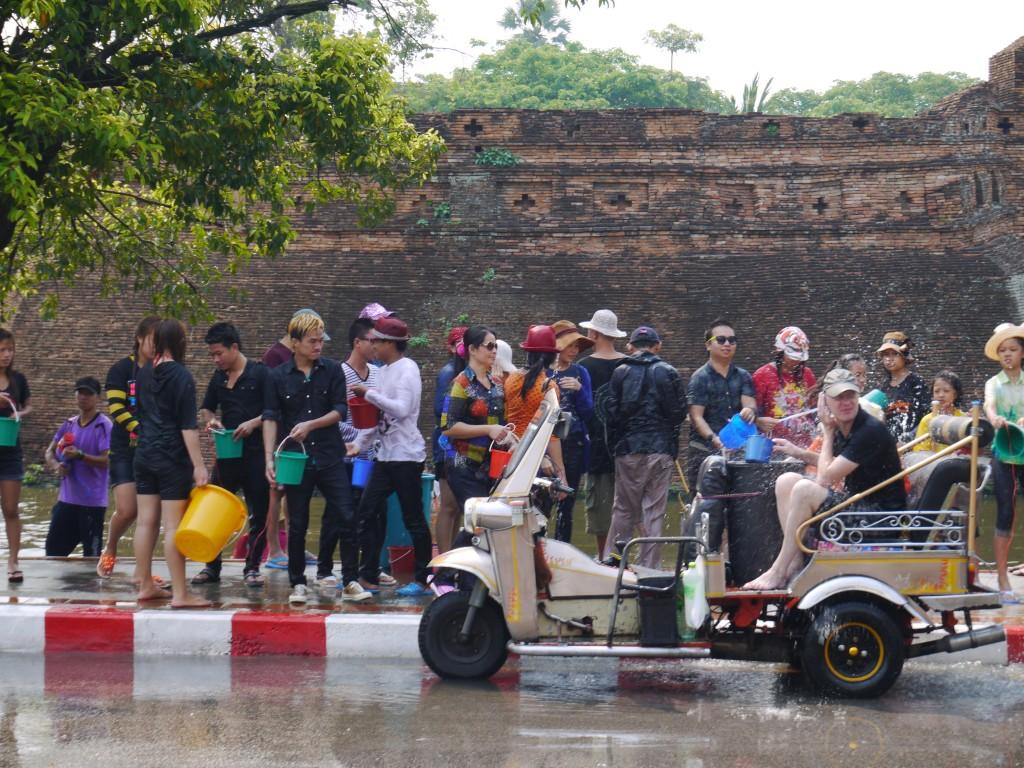 Tuk Tuk Passenger Getting Drenched At Chiang Mai Songkran