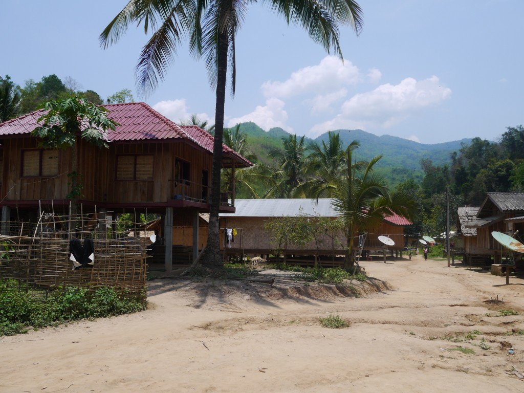 Hill Tribe Village At The Edge Of The Mekong In Laos