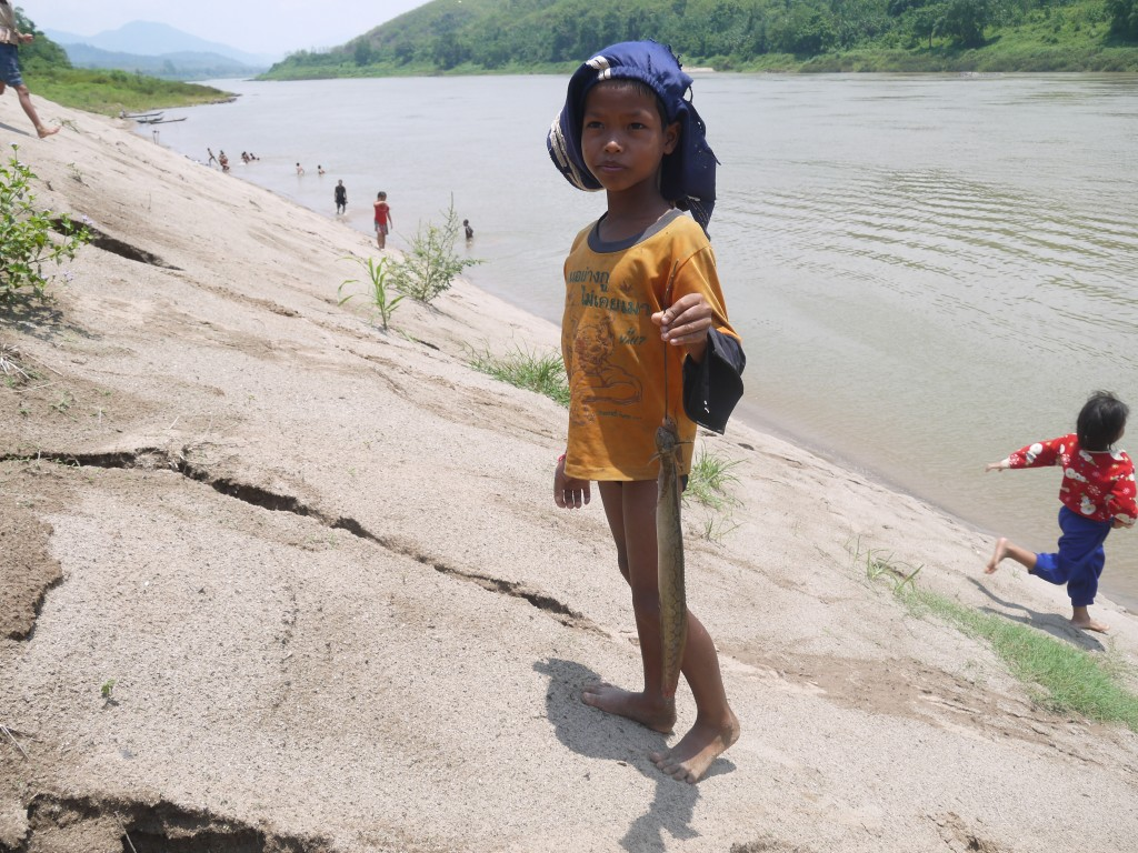 Hill Tribe Boy With The Fish He Caught In The Mekong River