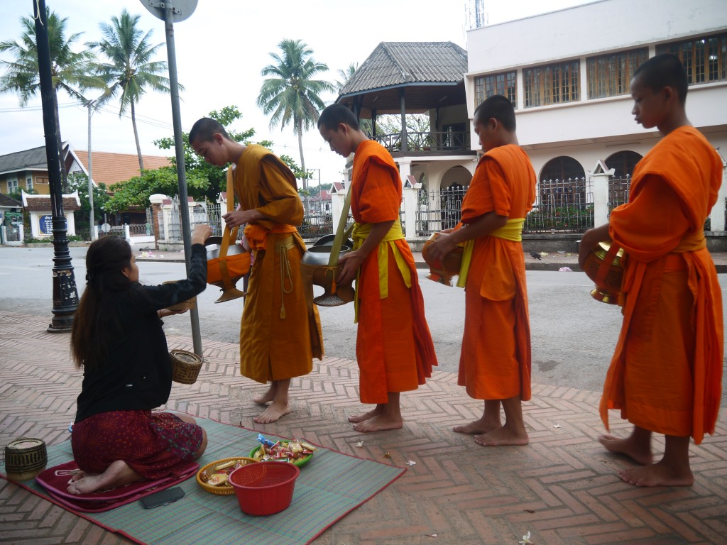 Monks Accepting Food At The Morning Alms Giving Procession