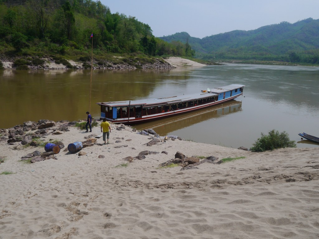 Our Boat Waiting At A Sandy Beach On The Mekong River