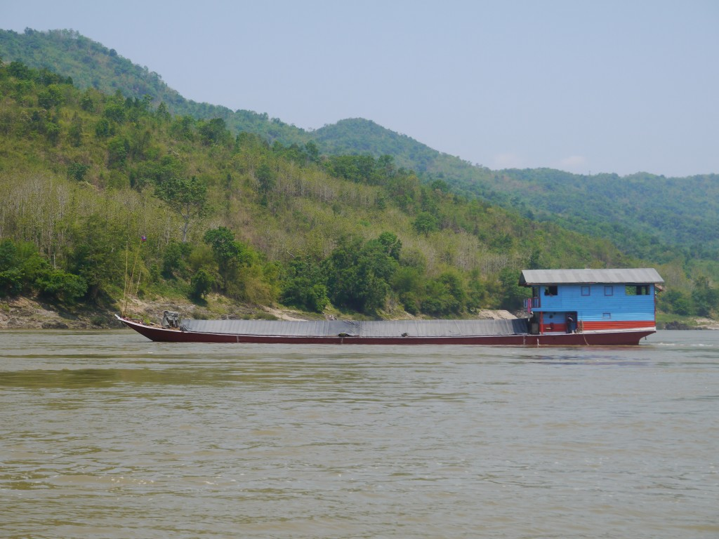Boat Carrying Sticky Rice Down The Mekong River