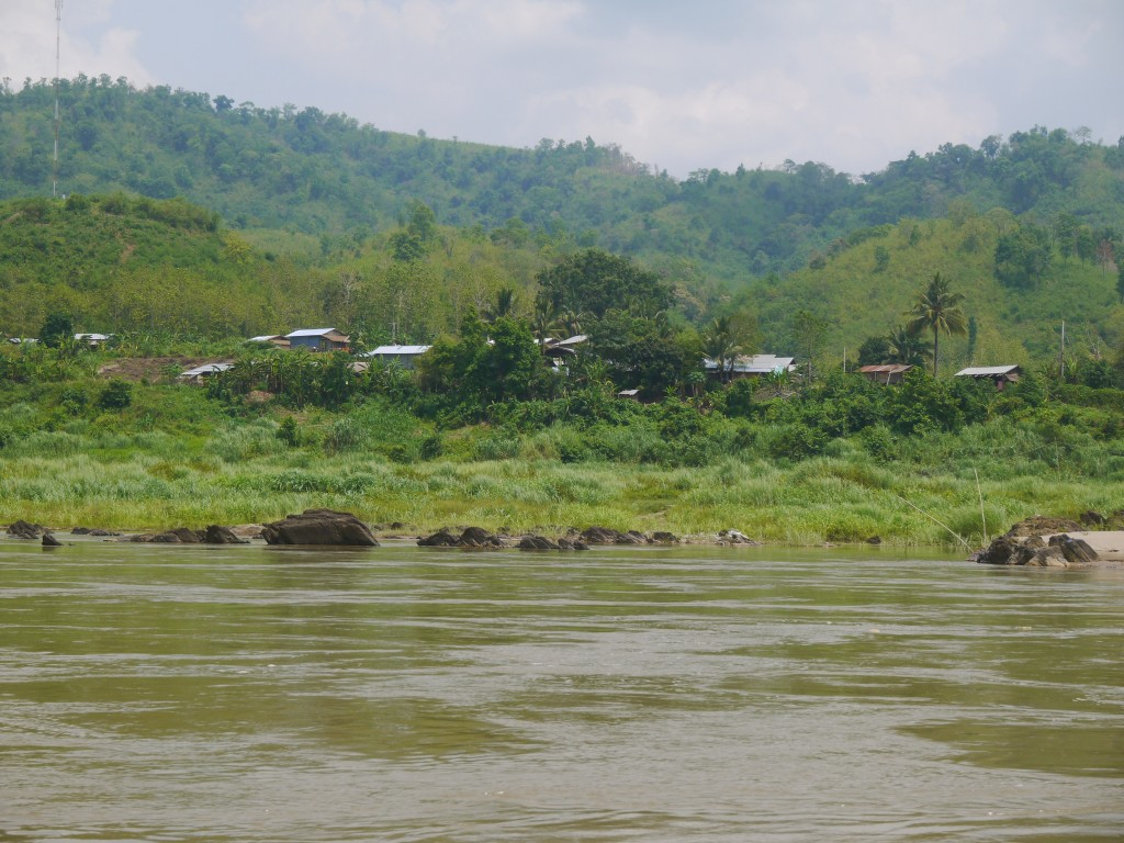 A Hill Tribe Settlement Beside The Mekong River In Laos