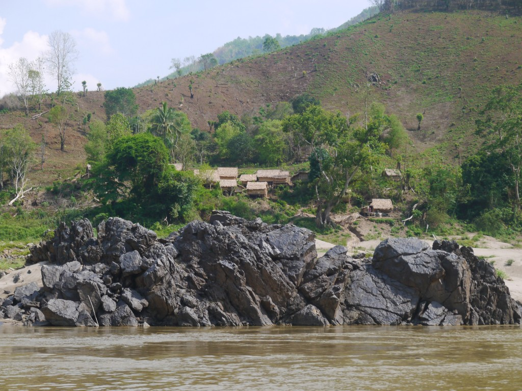 Another Hill Tribe Settlement Beside The Mekong River In Laos