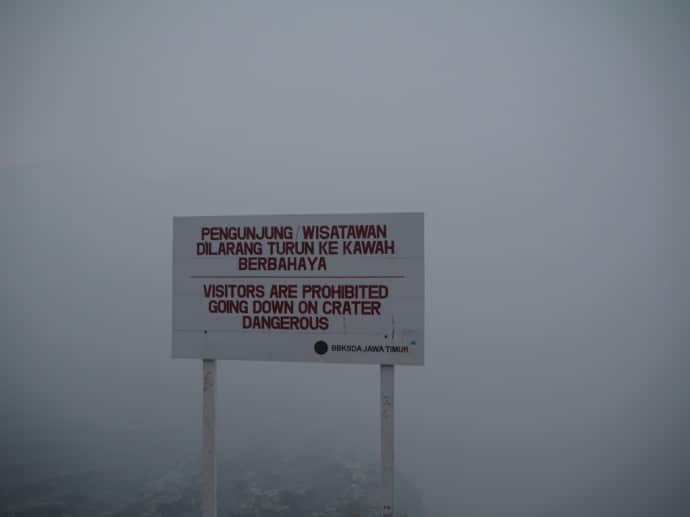 Warning Sign At Top Of Crater