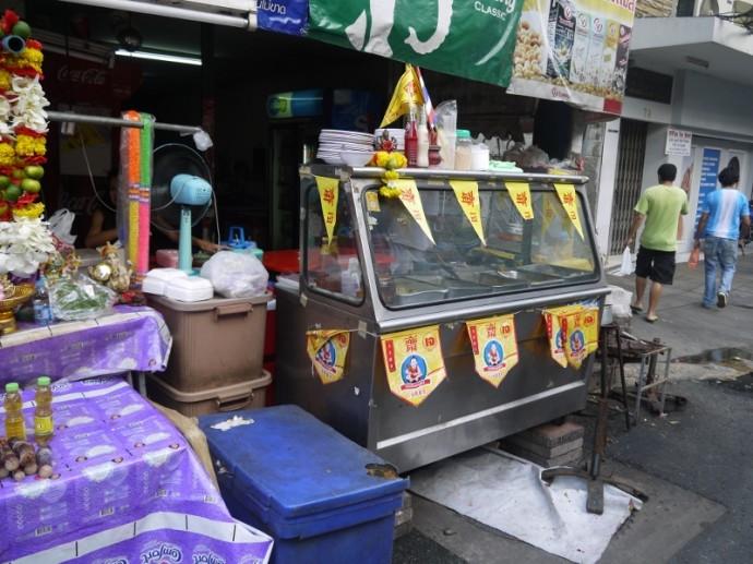 Yellow Veggie Flags On Pan Road Veggie Stall