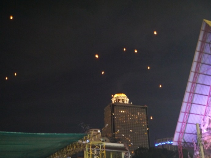 Lanterns Floating Against A Backdrop Of State Tower