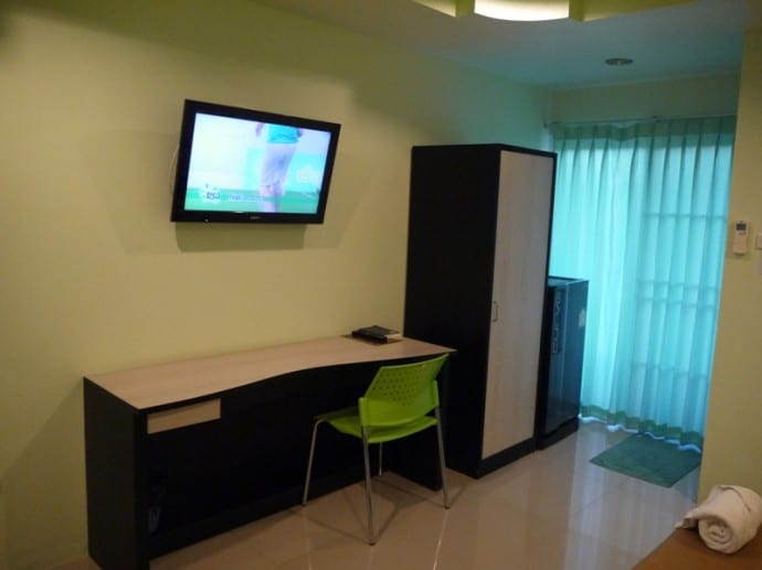 Large Desk, Chair. TV, Wardrobe and Fridge At Better Place Hotel