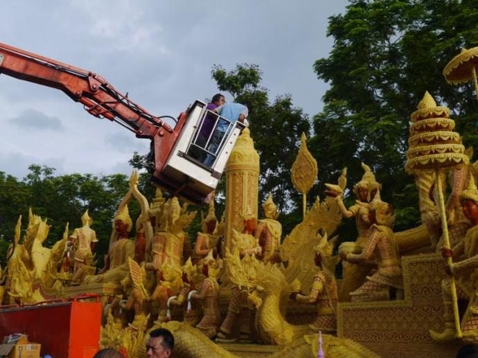 Adjusting A Candle At Ubon Ratchathani Candle Festival 2014