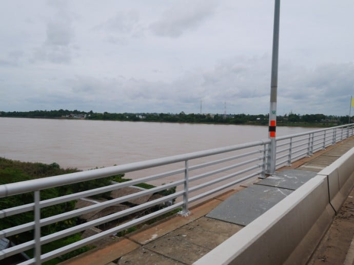 Crossing The Mekong River On The Thai-Lao Friendship Bridge