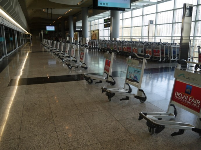 Trolleys Lined Up At Hong Kong Airport Station