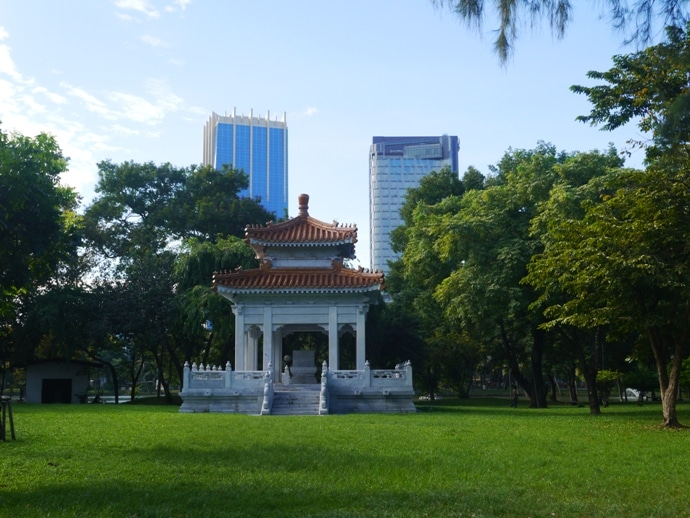 An Old Building In Lumphini Park Contrasts With Modern Skyscrapers