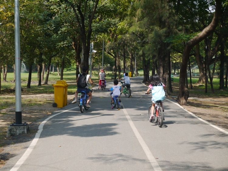 Families Cycling At Rot Fai Park, Bangkok