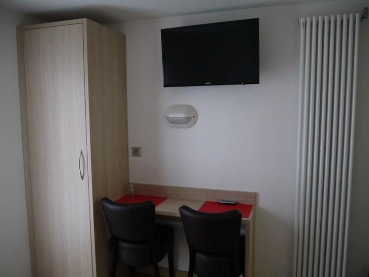 Wardrobe, Desk & TV At Hotel Darcet, Paris